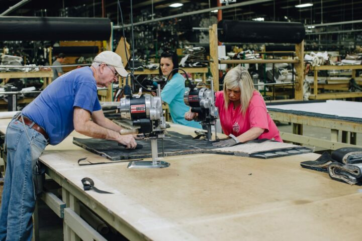 Fusion Furniture employees sewing fabrics together
