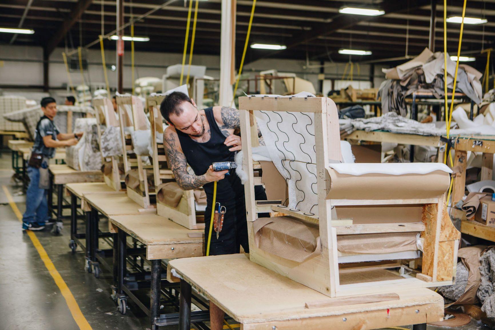 Fusion Furniture employee assembling chair