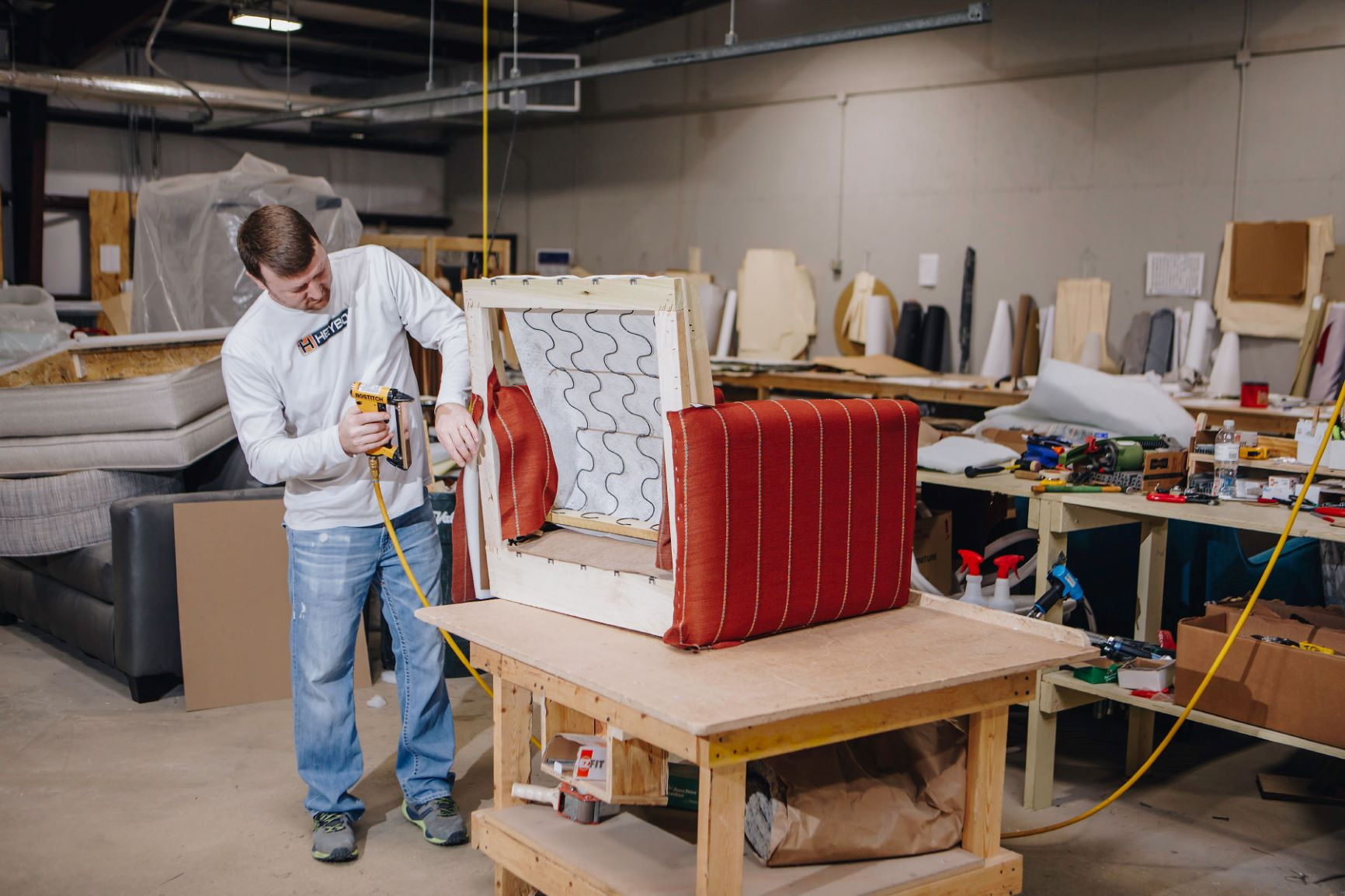 Fusion Furniture employee building a new product