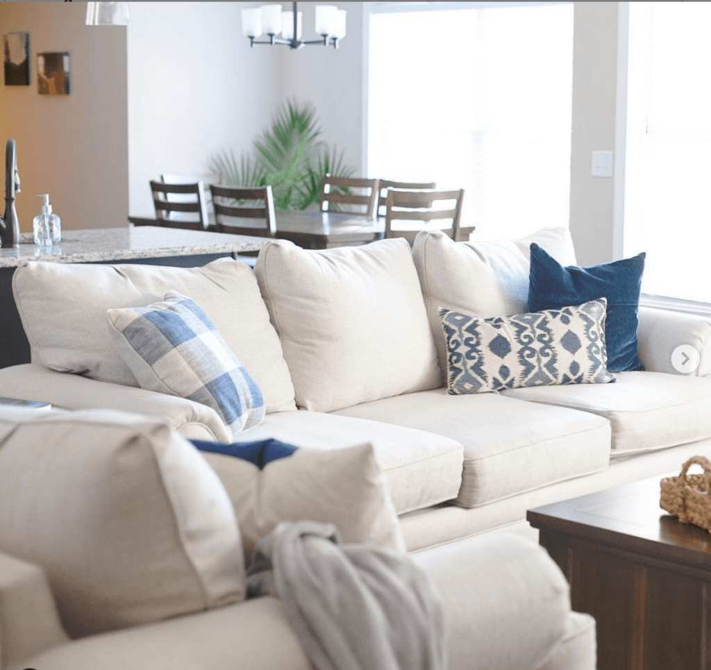 White Fusion Furniture sofa and chair decorated with blue pillows