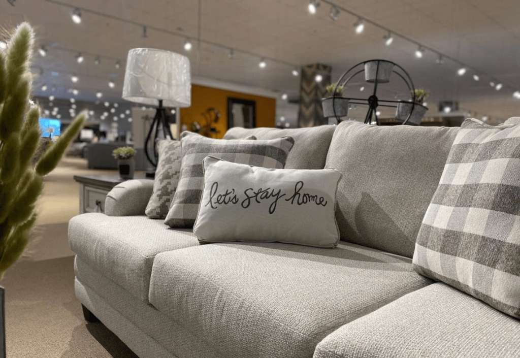 Fusion Furniture sofa and throw pillows in retailer showroom