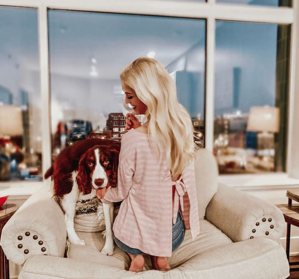Girl and her dog enjoying a Fusion Furniture chair together