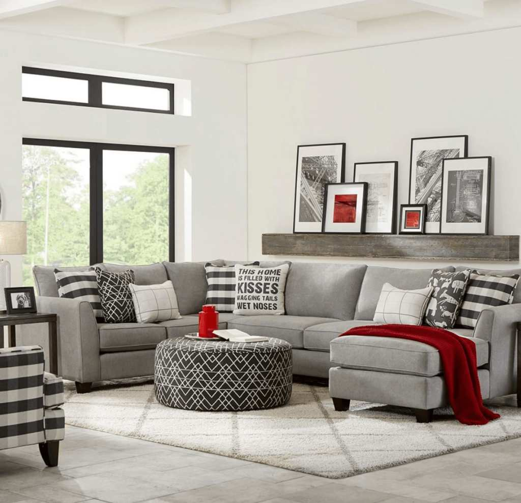 Grey Fusion Furniture sectional with accent chair and ottoman