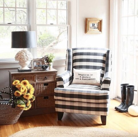 Checkered Fusion Furniture chair with throw pillow