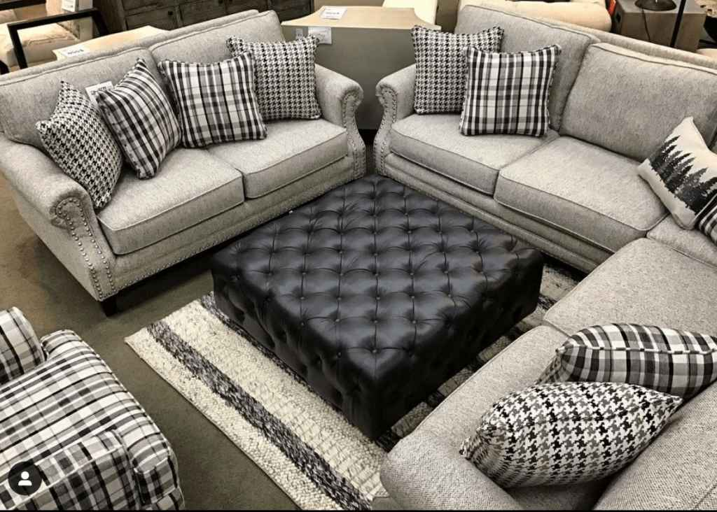 Grey Fusion Furniture sectional, sofa, ottoman and chair in retailer showroom
