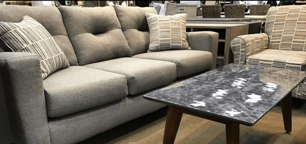 Fusion Furniture sofa and accent chair in retailer showroom