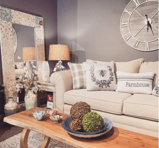 Fusion Furniture sofa with throw pillows in retailer showroom